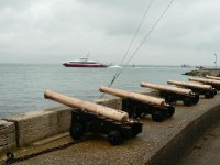 Not the largest cannons on the sea wall at Cowes, would probably not do any damage to the ferry