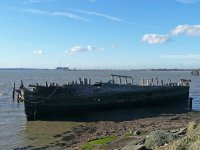 An old boat rotting away on the River Thames