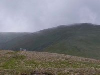 Looking back to the mountain hut, and The Cheviot in the low cloud