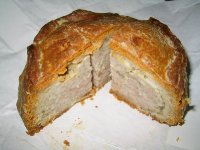 The succulent insides of a glorious  pork pie from Dickinson & Morris Ye Olde Pork Pie Shoppe in Melton Mowbray