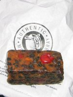 A piece of Melton Mowbray Hunt Cake, released from it\'s packaging