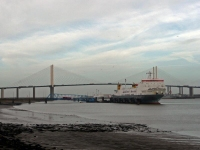 A ship unloading with the Dartford Bridge in the background