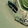 An old boat rotting away on the River Thames from GoogleEarth