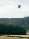 A balloon in the morning haze, floating above the South Downs