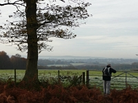 The view from Piltdown across to the South Downs, with Tim leaning on gate