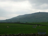 The view back over Cowling to the monuments on Earl Crag at the start of day 5