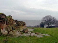 A rare outcrop of rocks (overlooking Weirwood Reservoir in the mist)