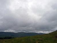 A windfarm on the horizon, taking a break walking up Benbrack