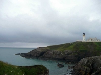 Lighthouse (and foghorn) at Black Head, before the path heads East