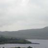 2 people fishing in the pouring rain at Loch Dee
