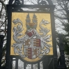 A coat of arms on the gateway to Oldlands Hall