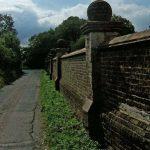 The wall near Flint House, the round brick balls are fabulous
